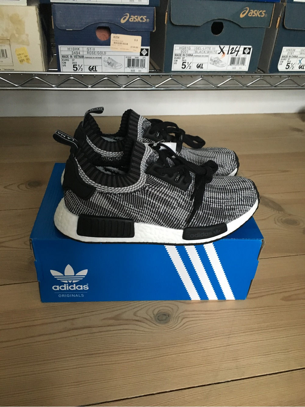 adidas nmd r1 nomad boost core black grey red glitch camo
