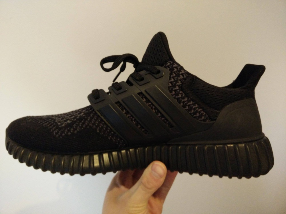 official photos e1344 47c41 ... real adidas ultra boost triple black release date 10a32 685f7