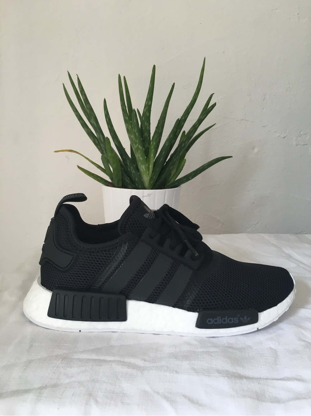The adidas NMD R1 'Legion Ink' Features Gum Coloured Plugs