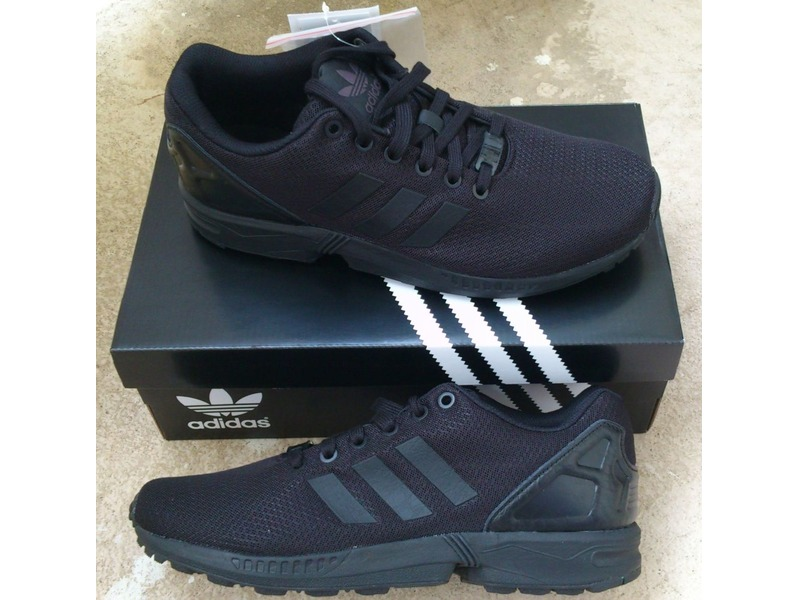 new product 3386e c5110 adidas all black zx flux